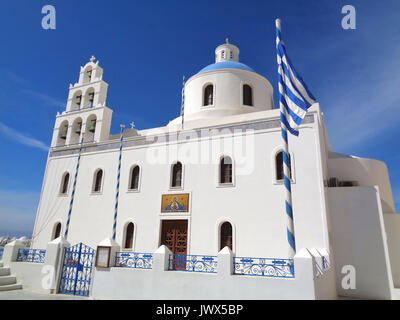 White Colored Church of Panagia of Platsani against Vivid Blue Sky at Oia Village of Santorini Island, Greece - Stock Photo
