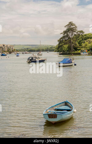 Small boats moored at Kingsbridge at the end of the Salcombe - Kingsbridge Estuary, south Devon, UK. - Stock Photo
