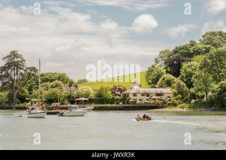 Small boats and yachts moored at Kingsbridge at the end of the Salcombe - Kingsbridge Estuary, south Devon, UK. - Stock Photo