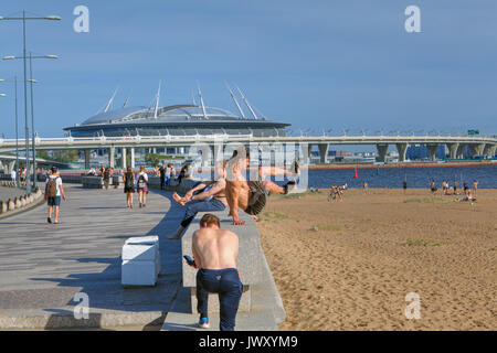 St. Petersburg, Russia - August 1, 2017: Park named after St. Petersburg tercentenary, man practicing parkour in - Stock Photo