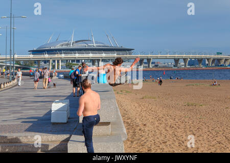 St. Petersburg, Russia - August 1, 2017: Park 300th anniversary of St. Petersburg, young man practicing parkour - Stock Photo
