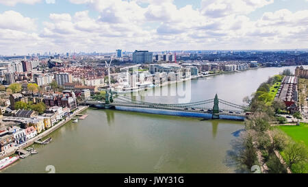 Aerial 4K Urban View Image Photo of Thames River and Hammersmith Bridge in City of London England UK - Stock Photo