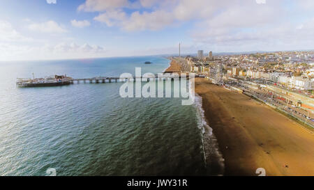 Aerial View Image of Brighton Pier with Seaside and Beach Coastline on a Sunny Day at East Sussex, England, UK - Stock Photo