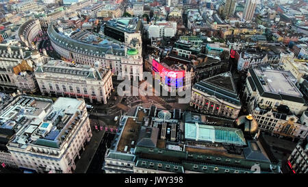Aerial View Photo of Iconic Landmark Piccadilly Circus Commercial Signs feat. Regent Street and Soho in London City - Stock Photo