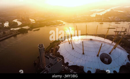 Aerial View Image Photo Flying by London O2 Arena Concert Hall by the River Thames Waterway at Sunrise Dawn Time - Stock Photo
