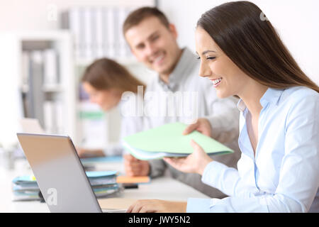 Busy colleagues coworking sharing documents at office - Stock Photo