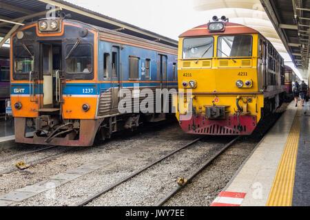 Diesel locomotives stood at platforms, Hua Lamphong railway station, Bangkok, Thailand - Stock Photo