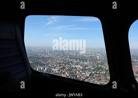aerial view of the London skyline through a helicopter window, London, UK - Stock Photo