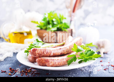 sausages with spice on white plate. stock photo - Stock Photo