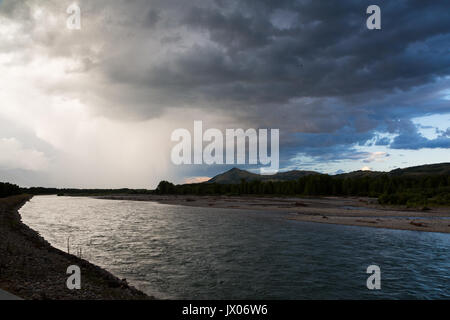 A large thunderstorm passing over the Snake River and Jackson Hole. Rendezvous Park, Wyoming - Stock Photo
