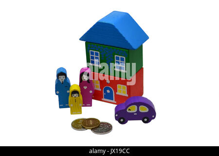 Miniature home, family and car standing near metal money on white background, Save money for prepare in the future - Stock Photo
