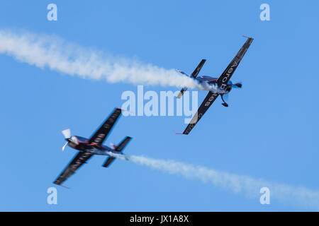 Two of The Blades aerobatic display team seen crossing above the seafront of Blackpool during the annual free airshow - Stock Photo
