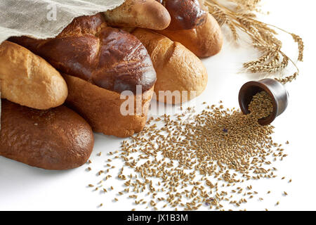 Assorted breads isolated on white  - Stock Photo