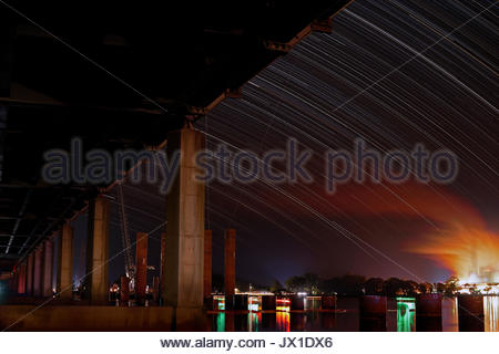 A long-exposure image of the Harwood sugar mill - on the Clarence River - from beneath the bridge, with the new - Stock Photo