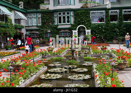 The Formal Italian Garden with Water Feature Planted Out with Red Geranium Flowers at Butchart Gardens Victoria - Stock Photo