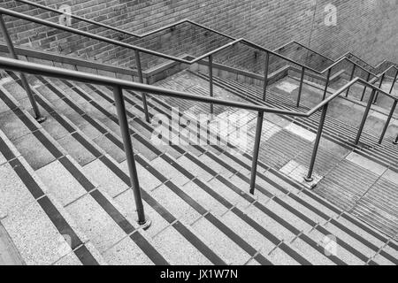 Concrete flight of steps with steel handrails - metaphor urban life, concept of climbing career ladder, corporate - Stock Photo