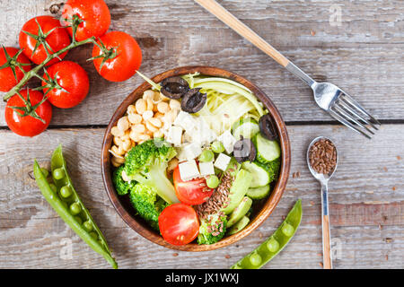 Green buddha bowl with zucchini pasta, sprouts chickpeas, tofu and vegetables. Love for a healthy vegan food concept. - Stock Photo