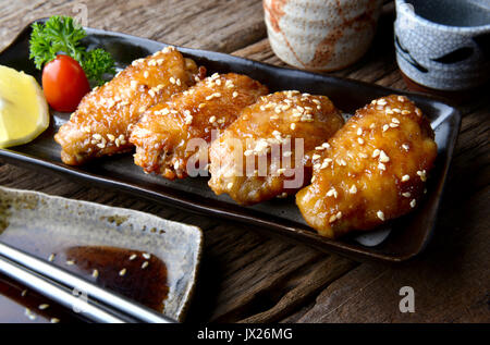Fried chicken wing with spicy sauce in Japanese style or Tebasaki wing serve in izakaya restourant. - Stock Photo
