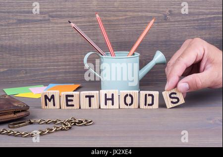 Methods concept.Wooden letters on dark background. Office desk - Stock Photo