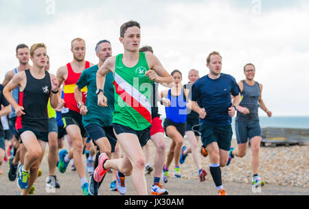 Runners on the weekly Vitality Parkrun event in Worthing, West Sussex, England, UK. - Stock Photo