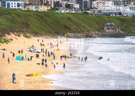 Holidaymakers enjoying themselves on Fistral Beach in Newquay, Cornwall.