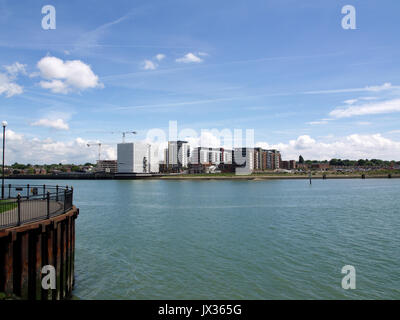 View of Centenary Quay development in Woolston, Southampton, looking across River Itchen from Ocean Village - Stock Photo
