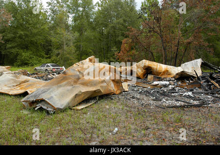 Burned mobile home in a rural area of North Florida. - Stock Photo
