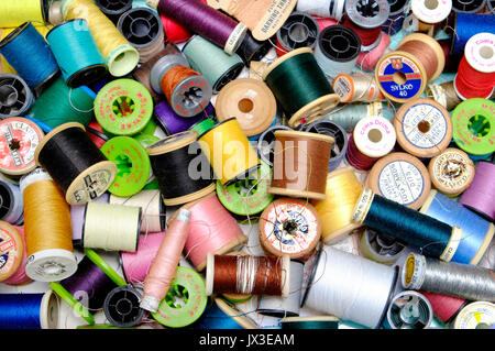 colourful cotton reels in sewing box - Stock Photo