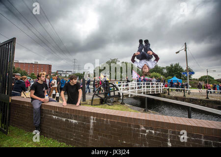 Boys and young men doing parkour - Stock Photo