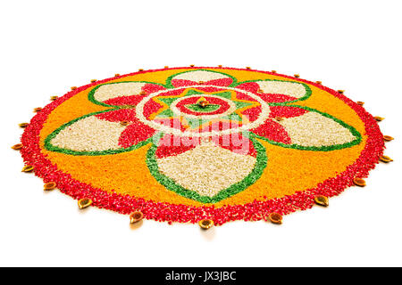 Indian Traditional Diwali festival flower rangoli with Diyas - Stock Photo
