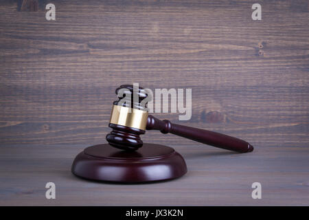 wooden gavel on wooden table Law and justice concept. - Stock Photo