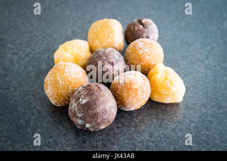 Timbits (donut holes, doughnut holes) from Tim Hortons, a popular Canadian fast food restaurant chain. - Stock Photo