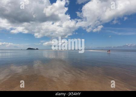 Walking on the water at Hin Kong Beach, Koh Phangan island, Thailand - Stock Photo