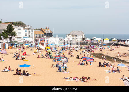 Holiday resort, Broadstairs. Viking bay, the main beach with many people, locals and tourists sunbathing. View along - Stock Photo