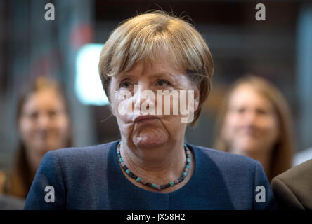 Gelnhausen, Germany. 14th Aug, 2017. German Chancellor Angela Merkel (CDU) listens to a organ playing during a campaign - Stock Photo