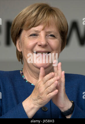 Gelnhausen, Germany. 14th Aug, 2017. German Chancellor Angela Merkel (CDU) applauds during a campaign appearance - Stock Photo