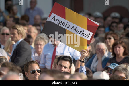 Gelnhausen, Germany. 14th Aug, 2017. A supporter holds up a poster saying 'Angela Merkel' while German Chancellor - Stock Photo