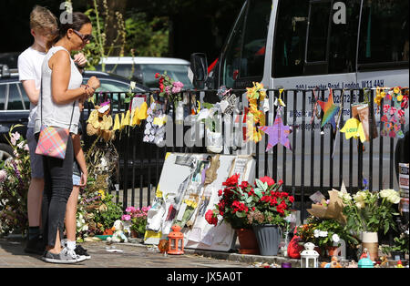 Grenfell Tower. West London. 14 Aug 2017 - People views the floral shrine two month since Grenfell residential tower - Stock Photo