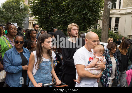 London, UK. 14th August, 2017. Hundreds of people take part in a silent march to demand justice for the victims - Stock Photo