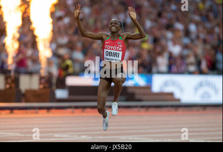 HELLEN ONSANDO OBIRI of Kenya celebrates winning her Gold Medal in the 5000m metres after winning the final in a - Stock Photo