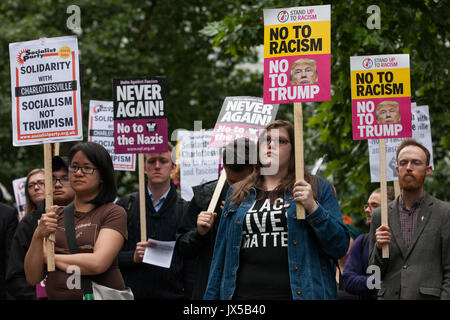 London, UK. 14th August, 2017. Supporters of Unite Against Fascism hold a vigil outside the US embassy in solidarity - Stock Photo