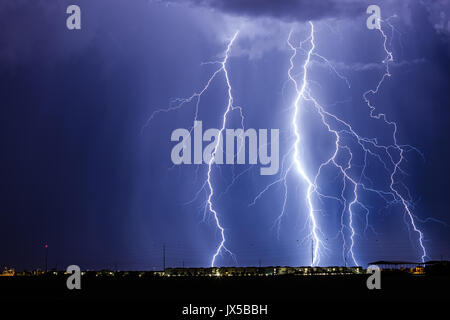 Chandler, USA. 14th Aug, 2017. Lightning fills the sky as early morning monsoon thunderstorms bring heavy rain and wind in Chandler, USA. Credit: John Sirlin Credit: John Sirlin/Alamy Live News Stock Photo