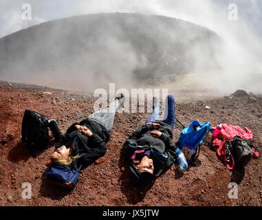 Kamchatka Territory, Russia. 12th Aug, 2017. Tourists at the crater of Avachinsky active stratovolcano. Credit: - Stock Photo