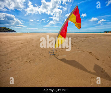 Warning flag at Three Cliffs Bay on the Gower coast of South Wales UK - Stock Photo