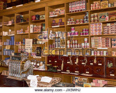 The stacked shelves in a Co-operative store in the 1900s in Beamish open air outdoor museum in Durham England UK - Stock Photo