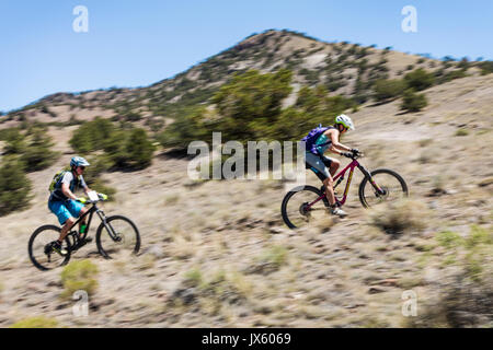 Male & female cyclists compete in the Fibark festival mountain bike race; Salida; Colorado; USAMale & female cyclists - Stock Photo