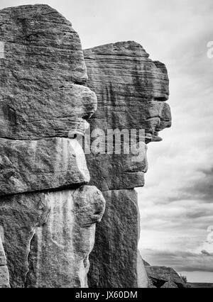 Millstone grit cliff faces with facial features at Burbage Edge near Hathersage in the Derbyshire PeaK District - Stock Photo