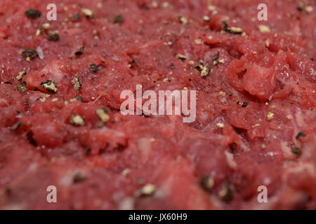 Tenderized and seasoned meat - Stock Photo