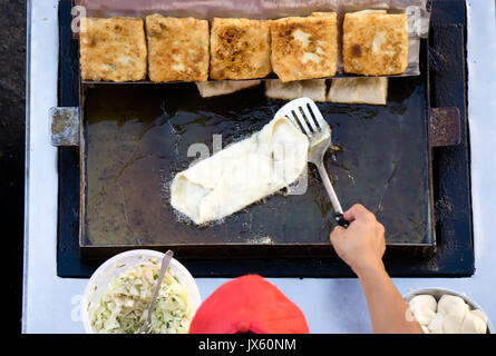 Top view of a man hand cooking vegetables martabak jawa in Kota Kinabalu City open market in Sabah Borneo. Martabak - Stock Photo