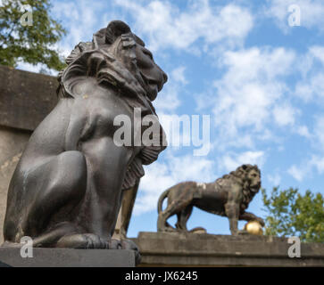 Bronze lions at the entrance gates to Victoria Park in Bath Spa Somerset close to the Royal Crescent - Stock Photo
